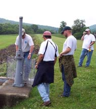 Inspection team evaluating a sluice gate.